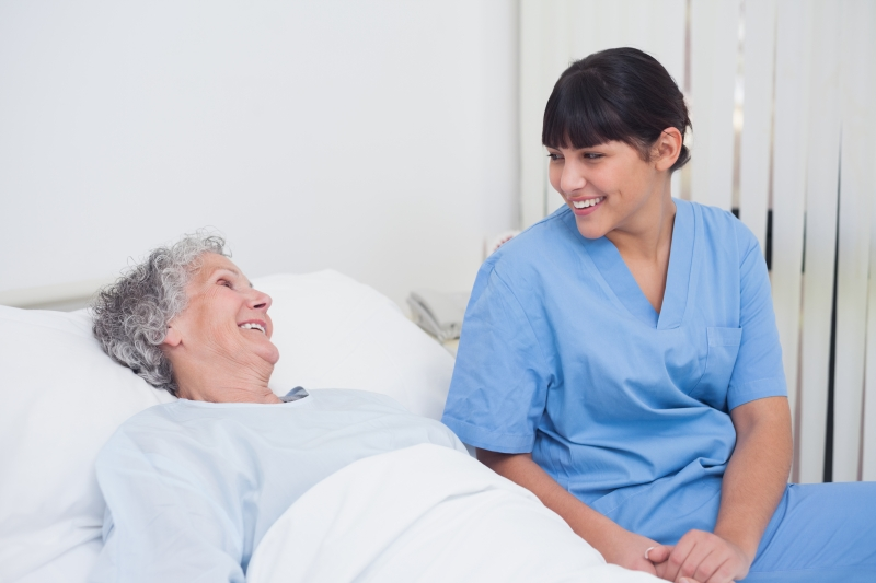 3598038-nurse-smiling-to-an-elderly-patient